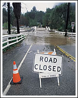 Image of a road closed from a flood