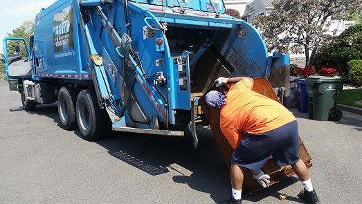 Refuse worker conducting a large item pick-up .
