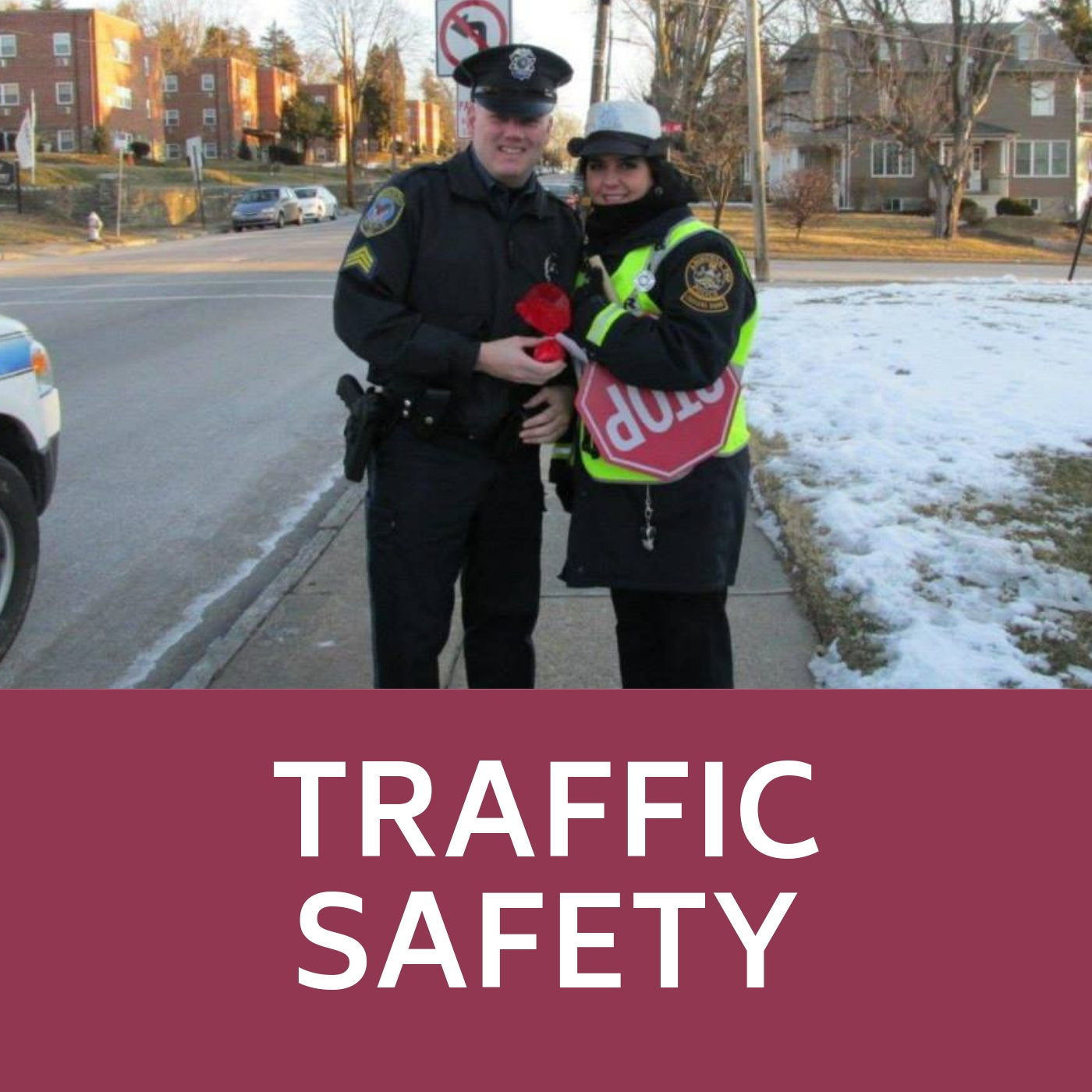 Crossing guard and police officer that links to traffic safety information