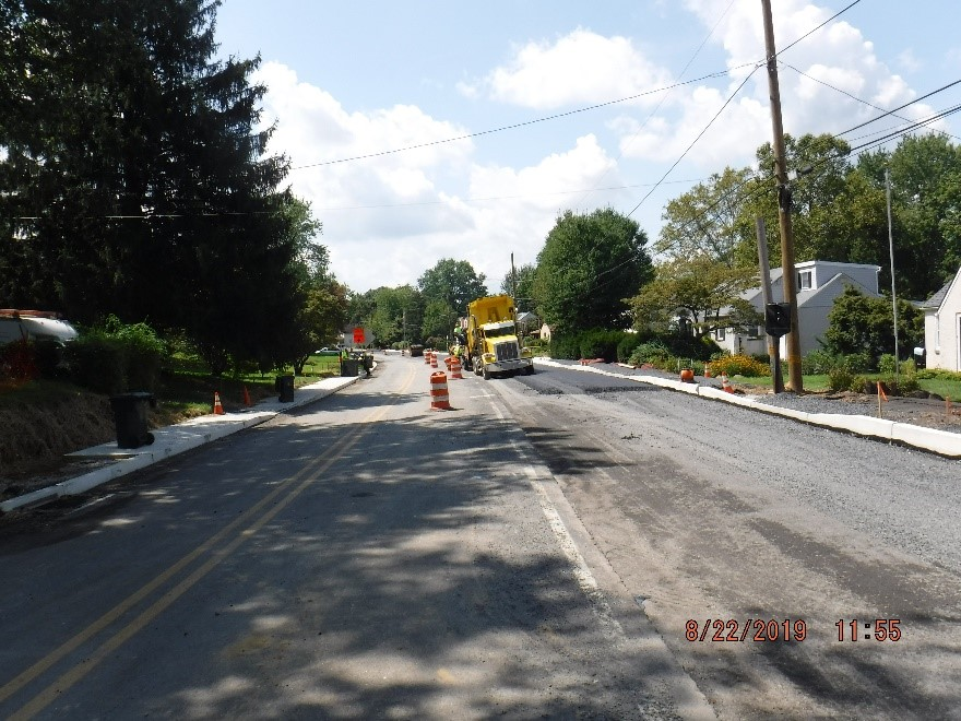 Asphalt paving on the north side of Tyson Ave.