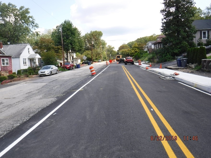 Asphalt paving on the south side of Tyson Ave.