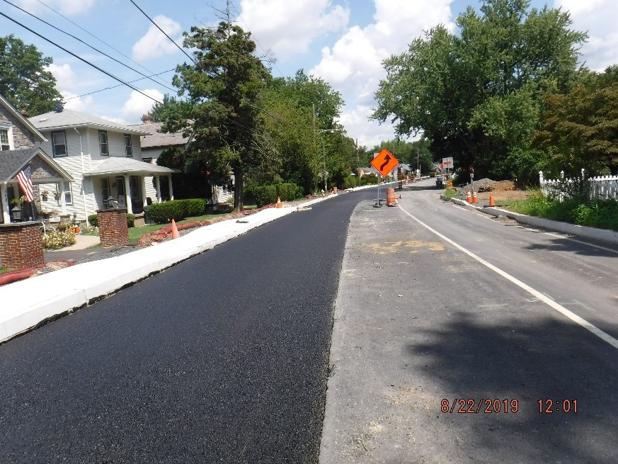 New asphalt pavement on the north side of Tyson Ave.