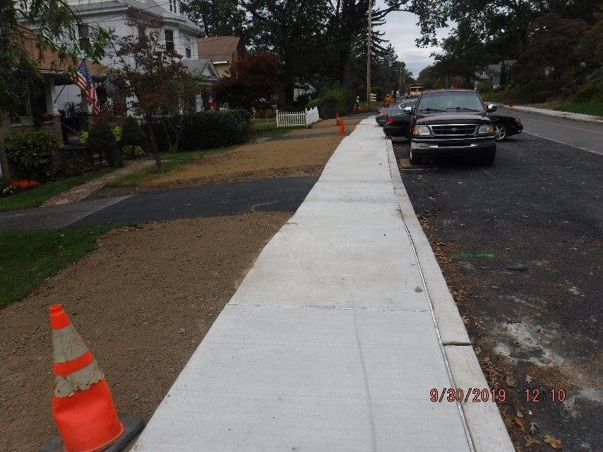 New concrete curb and sidewalk construction on the north side of tyson