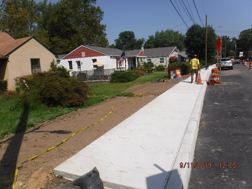 New concrete curb and sidewalk construction on the north side of Tyson Ave. east of Edgecomb Ave