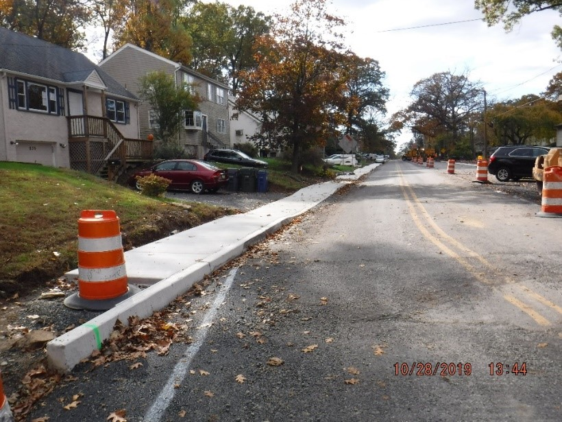 New concrete curb and sidewalk on the south side of Tyson west of Carson Avenue