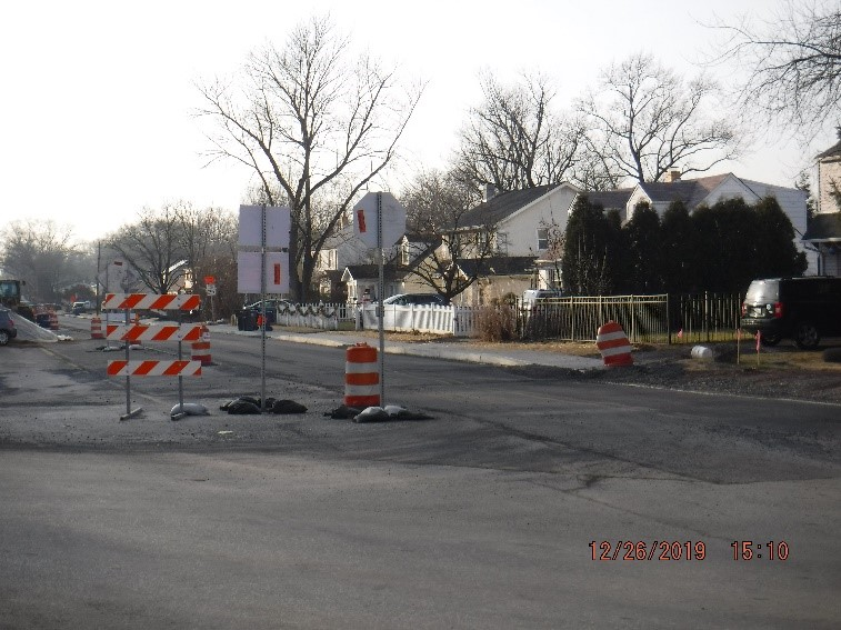 Asphalt pavement, curb and sidewalk construction on Tyson Ave. west of Bradfield Rd.