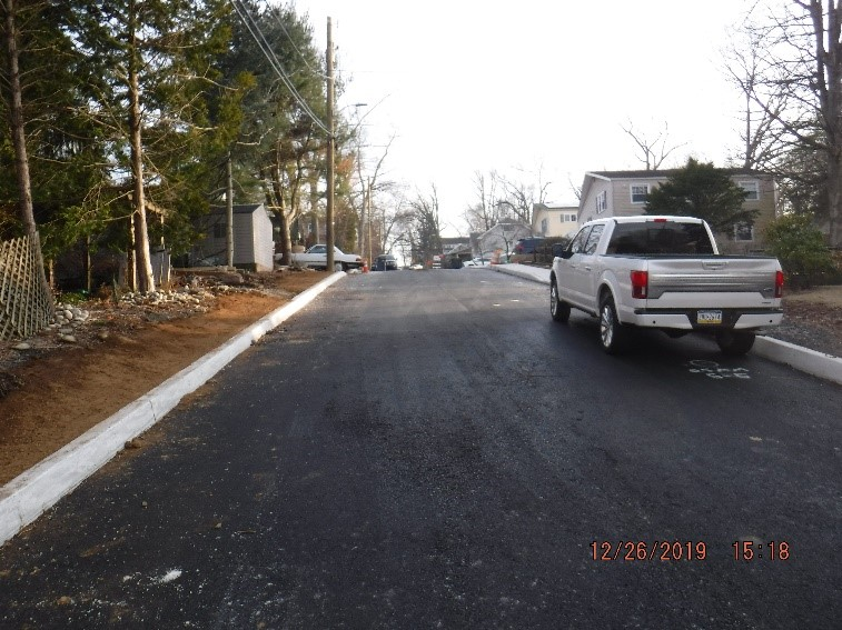 New asphalt, curb and sidewalk construction on Edgecomb Avenue