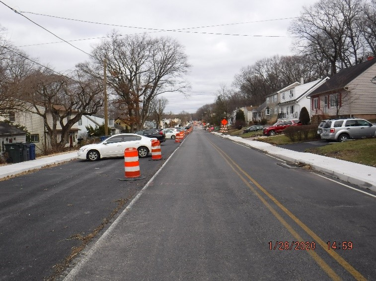 Asphalt pavement, curb and sidewalk construction on Tyson Avenue east of Edgecomb Avenue