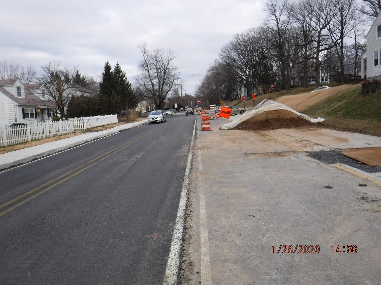 Asphalt pavement, curb, and sidewalk construction on Tyson Avenue west of Bradfield Road