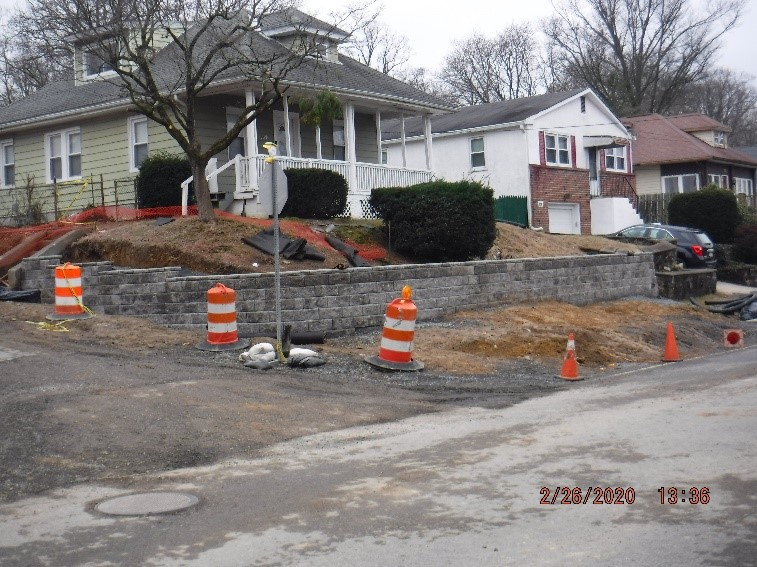 Landscape retaining wall construction at the intersection of Tyson and Custer Avenues
