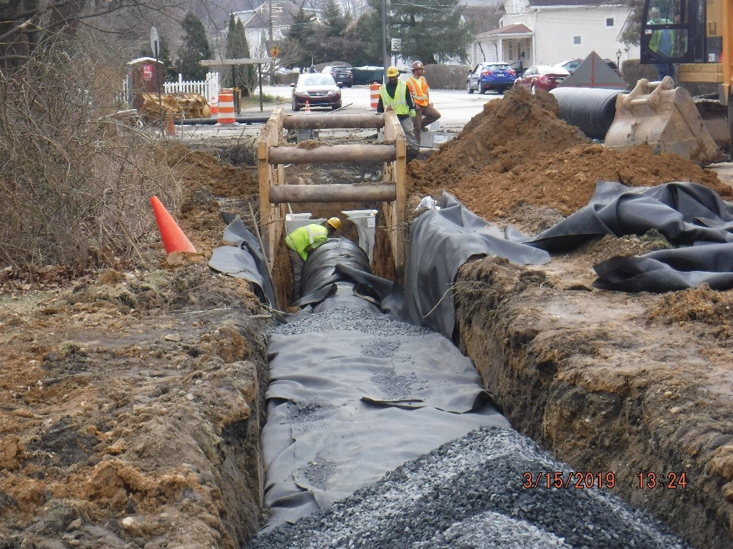 Pipe installation on Tyson Avenue