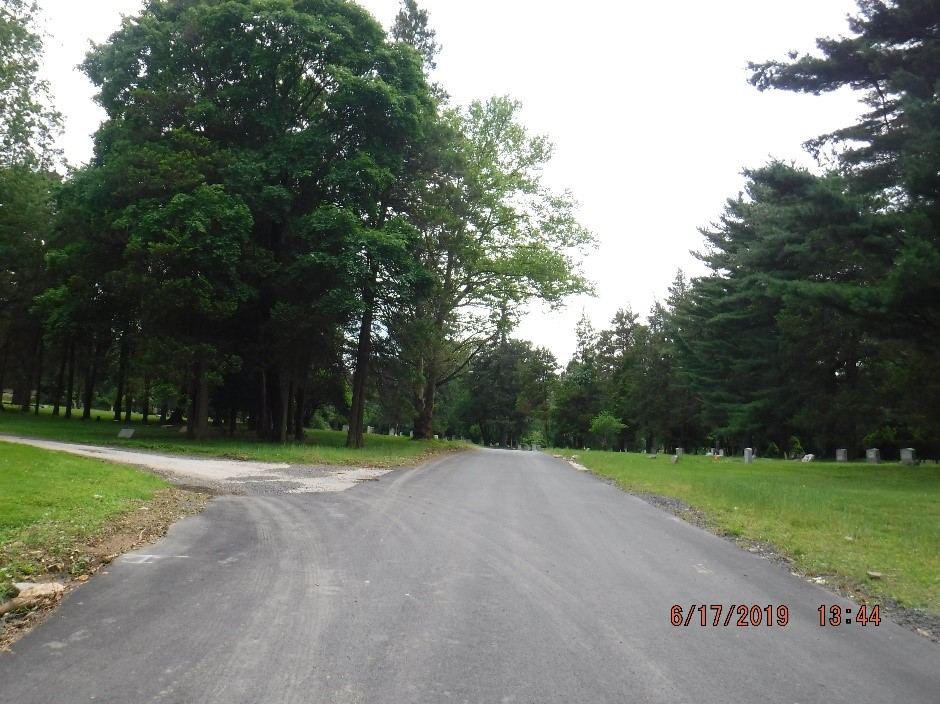 Asphalt paving on Hillside Drive in the cemetery.
