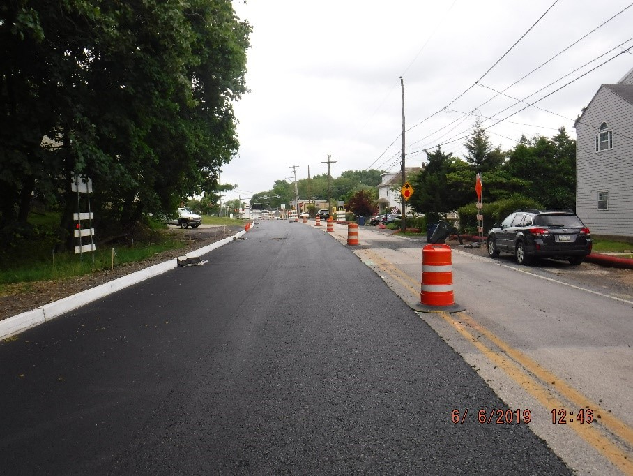 Asphalt paving on the south side of Tyson Avenue